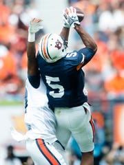 Auburn wide receiver Ricardo Louis catches a pass as Auburn defensive back Kamryn Melton guards him during the Auburn A-Day spring game on Saturday, April 18, 2015, at Jordan-Hare Stadium in Auburn, Ala.