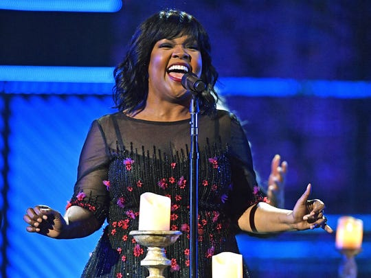 """CeCe Winans performs """"Never Have to be Alone"""" during the Gospel Music Association's annual Dove Awards at Lipscomb University on Tuesday in Nashville, Tenn. She won gospel artist of the year and contemporary gospel/urban album of the year for her latest album, """"Let Them Fall In Love."""""""