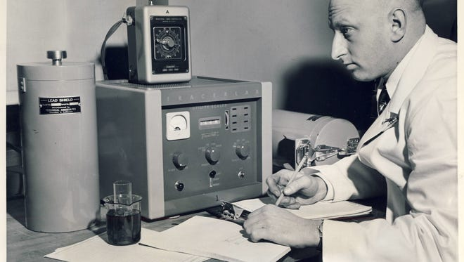 """Radioactivity in samples of tissue, blood or other substances may be measured by """"lead pig' detectors and a printer-recorder being used in 1953 at the Veterans Administration Hospital radioisotope laboratory by Martin H. Jachter."""