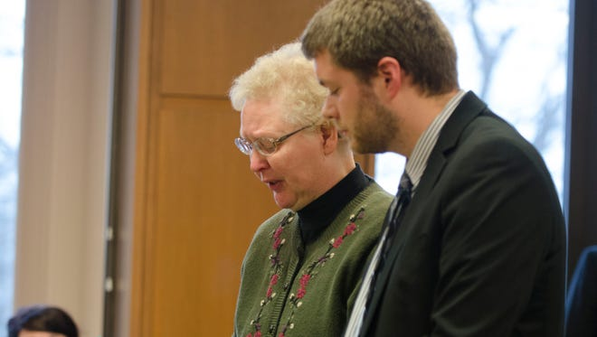Shirley Thoen reads a statement Thursday, Jan. 14 after pleading guilty in December to two counts of assault and battery of her students. Thoen was sentenced to 93 days in jail, with 73 days suspended upon completion of probation.