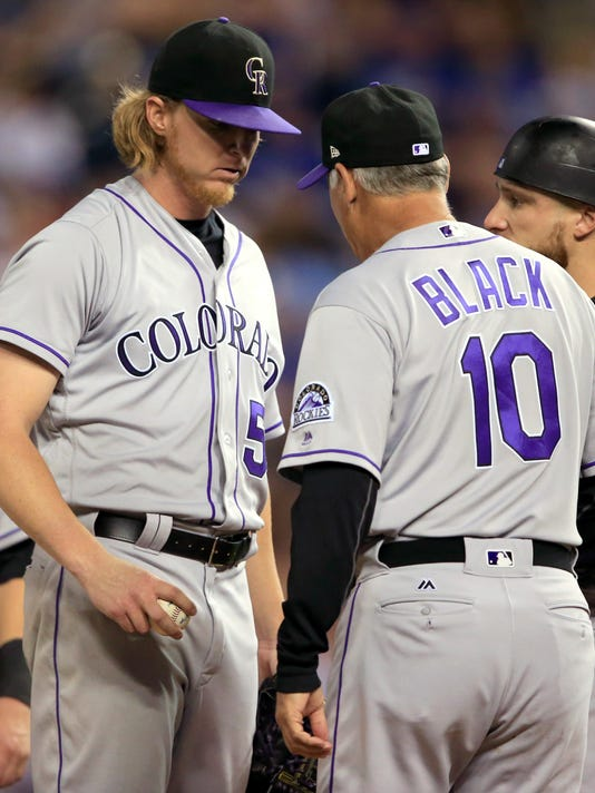 Colorado Rockies starting pitcher Jon Gray (55) hands the ball to manager Bud Black (10) during the seventh inning of a baseball game against the Kansas City Royals at Kauffman Stadium in Kansas City, Mo., Tuesday, Aug. 22, 2017. (AP Photo/Orlin Wagner)