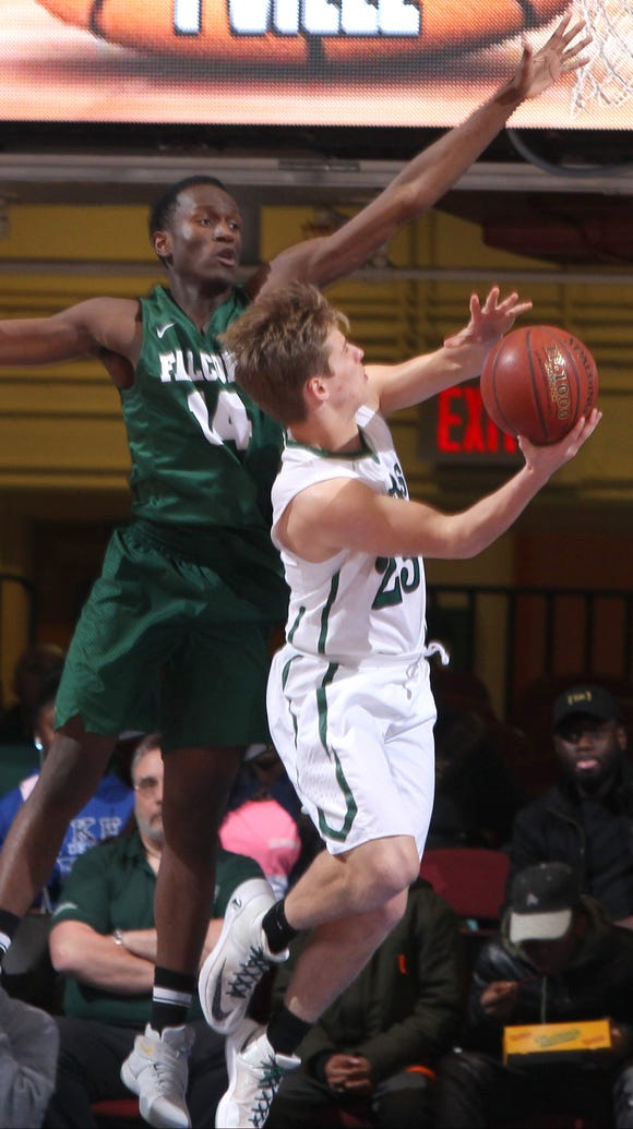 Pleasantville's Charlie McPhee is pressured by Woodlands' Noe Fleurimond during their Class B basketball semifinal at the Westchester County Center Feb. 27, 2017.