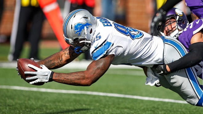 Lions tight end Eric Ebron scores a touchdown on a pass in the fourth quarter Sunday in Minneapolis.