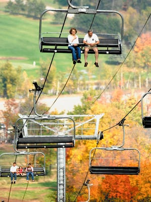 Visitors to Granite Peak Ski Area in Rib Mountain take a chairlift ride to view the region's fall colors.