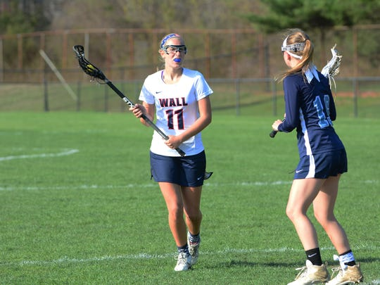 (SPORTS)            04/12/16               Wall, NJ Wall's Becky Kurfehs (11) is shown during a recent match against Freehold Twp.