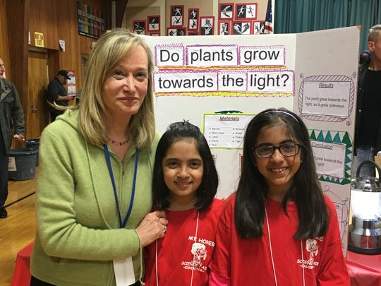 Mt. Horeb Reach teacher and science fair organizer Wendy Piller with 4th graders Aanya and Eesha Lal, two of the young scientists who exhibited at the 7th Annual Mt. Horeb Science Fair on March 18.