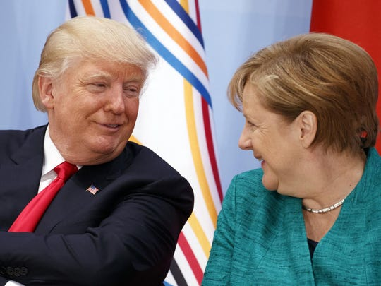 President Donald Trump talks with German Chancellor Angela Merkel during the Women's Entrepreneurship Finance event at the G20 Summit, in Hamburg, Germany earlier this year.