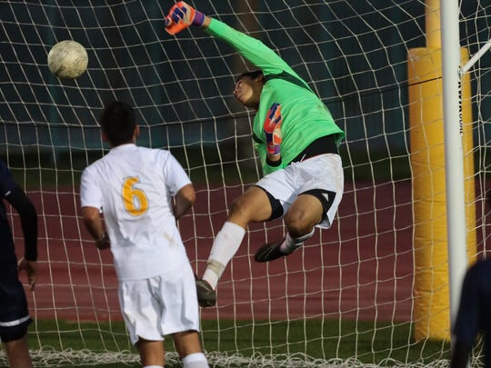 A close call for La Quinta as a Coachella Valley ball goes over keeper Sebastian Ascencio in the first half.