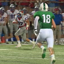 A Westlake player runs the ball in a game against Southlake Carroll on August 29, 2014.