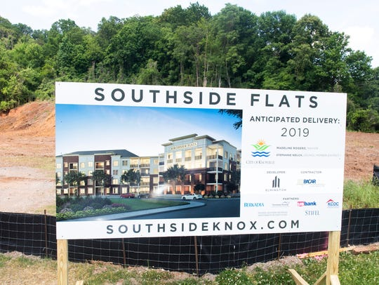 A rendering of Southside Flats is displayed on a sign