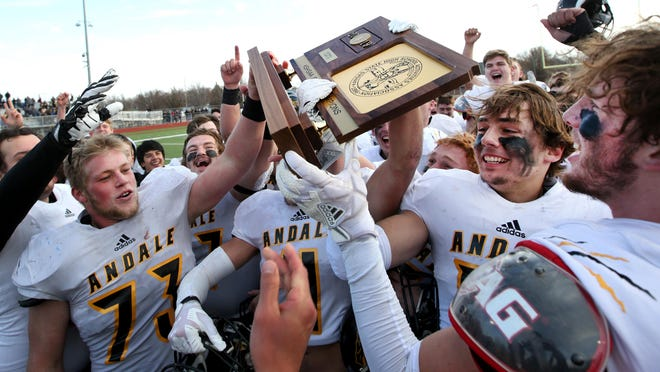 Andale Indians hold up their championship trophy during the Class 3A State Football Championships after they defeated Perry-Lecompton 35-7 Saturday afternoon, Nov. 30, 2019, at Gowans Stadium in Hutchinson.