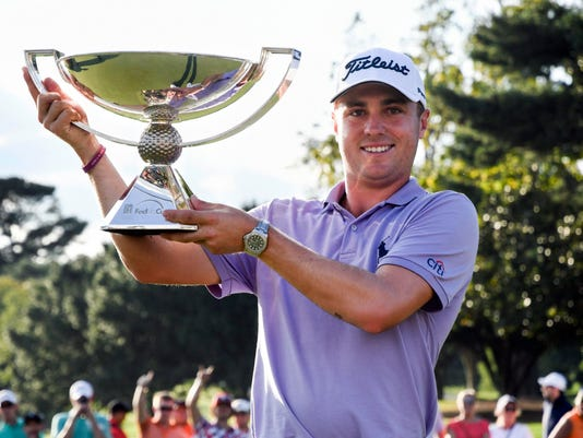 FILE - In this Sept. 24, 2017, file photo, Justin Thomas holds the trophy after winning the Fedex Cup after the Tour Championship golf tournament at East Lake Golf Club in Atlanta. Justin Thomas walked away with the richest payoff in golf when he was runner-up at the Tour Championship and captured the FedEx Cup. With the $10 million bonus, he made $10,945,000 that day. And then he forgot all about it.(AP Photo/John Amis, File)