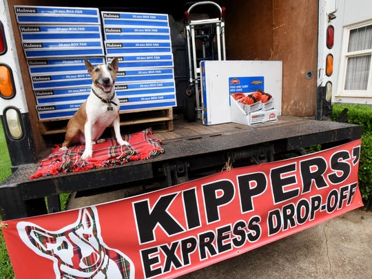 Mr. Kippers in the truck filled with supplies for animals in south Louisiana.