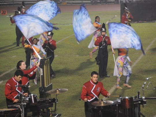 The James M. Bennett marching band performs at the