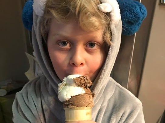 Brody Capra, 8, eats ice cream. His mom Wendy Capra