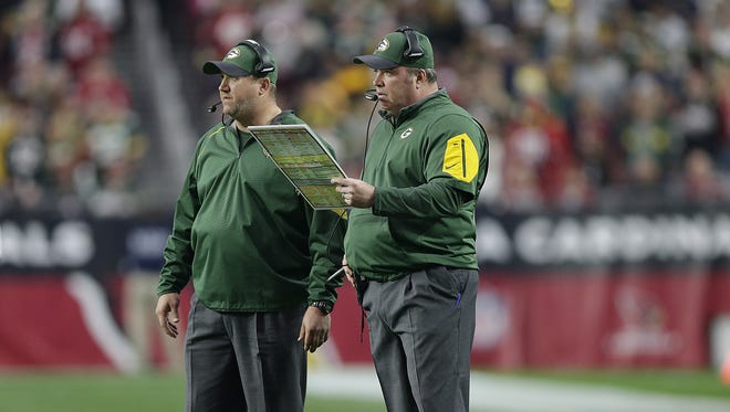 Green Bay Packers coach Mike McCarthy and quarterbacks coach Alex Van Pelt during the game at University of Phoenix Stadium.