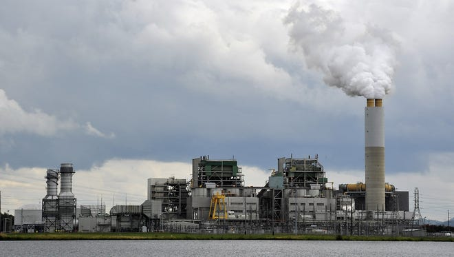 Duke Energy's existing Lake Julian plant mostly burns coal to generate electricity, but it will transition to natural gas.
