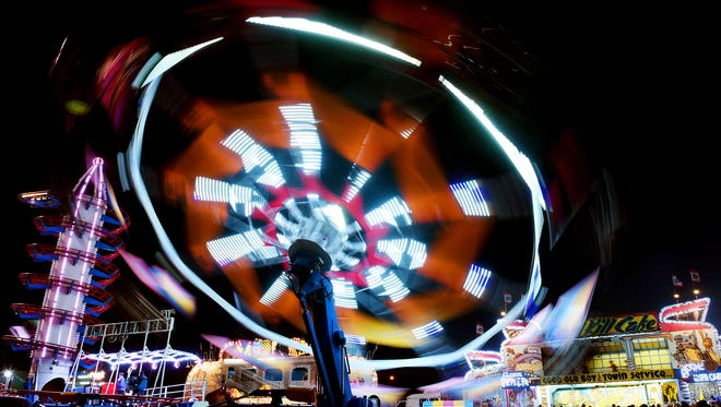 The midway of the Sioux Empire Fair is a blur of color on Monday night at the W.H. Lyon Fairgrounds.