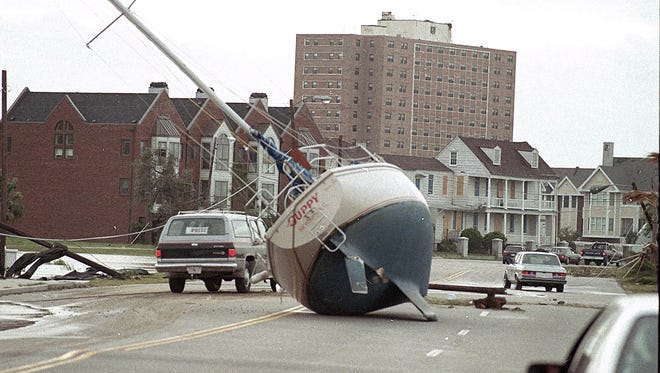 A sailboat lies in a Charleston street on Sept. 22, 1989. The devastation of Hurricane Hugo changed how the state responds to storms.