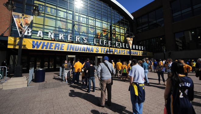 Fans gather outside Bankers Life Fieldhouse before the start of the Indiana Pacers and Atlanta Hawks first-round Eastern Conference playoff game, Saturday, April 19, 2014, in Indianapolis.