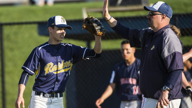 Elco's Clay Hain is congratulated by head coach Chris Weidner  following a 6-4 win on Wednesday, April 12, 2017. Weidner stepped down as head coach on Monday after 19 seasons.