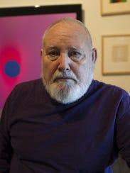 University of Iowa professor emeritus Hans Breder poses