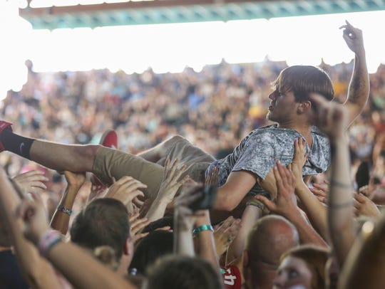 A fan crowdsurfs during Reel Big Fish's set at Warped