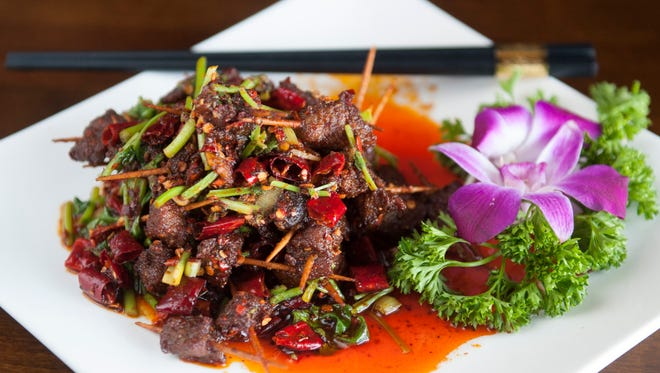 Toothpick Lamb is a stir fry of Chinese celery and cubed lamb seasoned with cumin and chili wherein each cube of lamb has been threaded onto a toothpick.