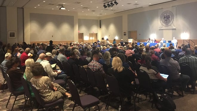 Virginians interested in weighing in on the potential environmental effects of the Atlantic Coast Pipeline pack the first Virginia Department of Environmental Quality public hearing on Monday, August 8, 2017, at James Madison University in Harrisonburg, Va.