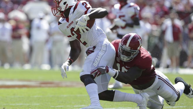 Sep 10, 2016; Tuscaloosa, AL, USA; Western Kentucky Hilltoppers wide receiver Taywan Taylor (2) is tackled by Alabama Crimson Tide linebacker Reuben Foster (10) at Bryant-Denny Stadium. Mandatory Credit: Marvin Gentry-USA TODAY Sports