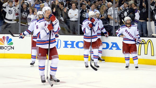 New York Rangers players react after their season ended with a 3-2 double-overtime loss to the Los Angeles Kings in Game 5 of the Stanley Cup finals Friday night. The Kings won the series 4-1.