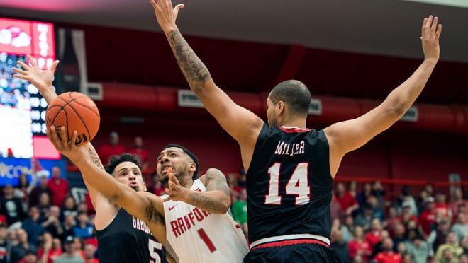 Radford's Carlik Jones drives to the basket against Gardner Webb in March 2019.