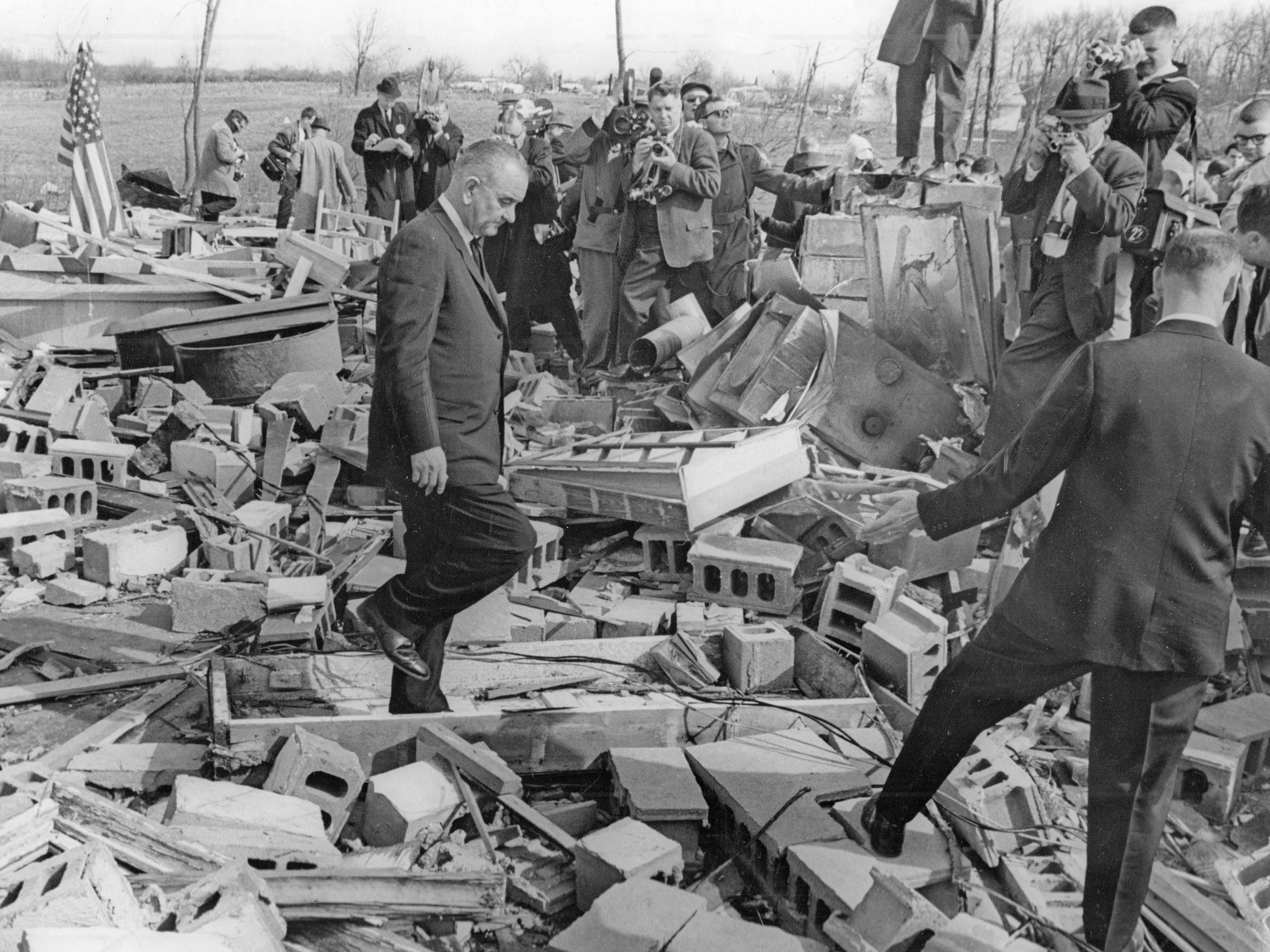 President Lyndon Johnson views the rubble at Dunlap following the Palm Sunday tornadoes on April 11, 1965. Johnson declared a state of emergency in Indiana.