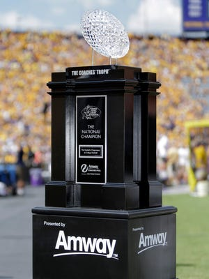 A view of the AFCA Coaches Trophy presented by Amway on the sidelines prior to the game between the Auburn Tigers and the Louisiana State Tigers. The Waterford Crystal Football is presented to the number one team in the Amway Coaches Poll and national champion at the end of the season. It has been awarded to the Coaches National Champion since 1986 and made available to all Coaches Poll winners since 1950.