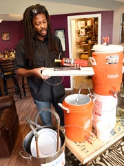 Desi Hall has been making homebrew for about four years and shows some of the things he uses Thursday, Oct. 6, at his home in St. Cloud.