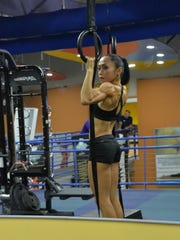 Rhea Macaluso does a variety of weight training exercises