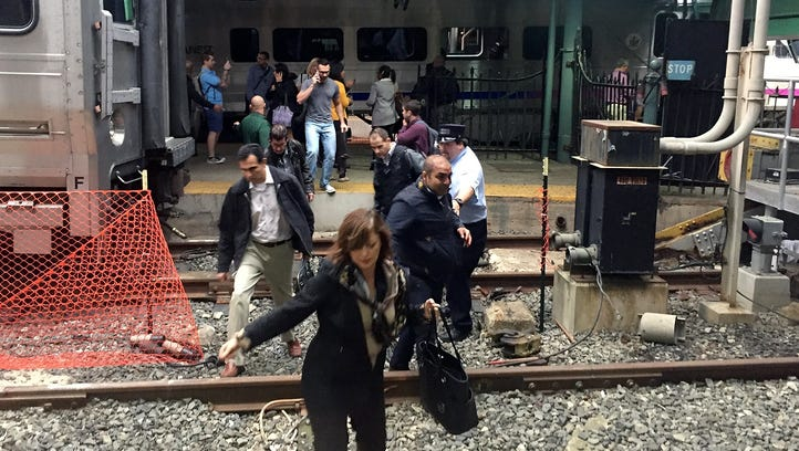 Passengers rush to safety after a N.J. Transit train