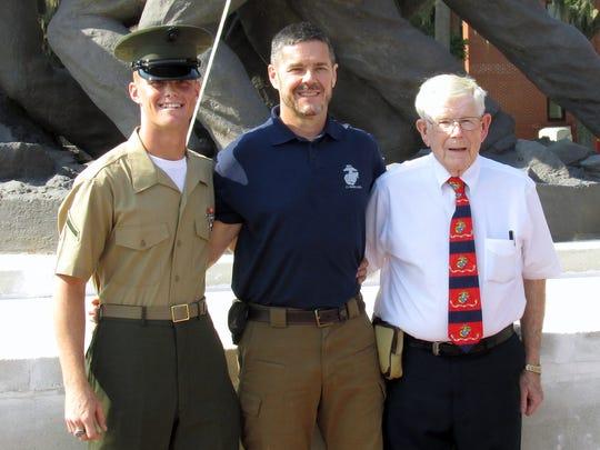 Jack Schamel of Chemung, right, joins his son John