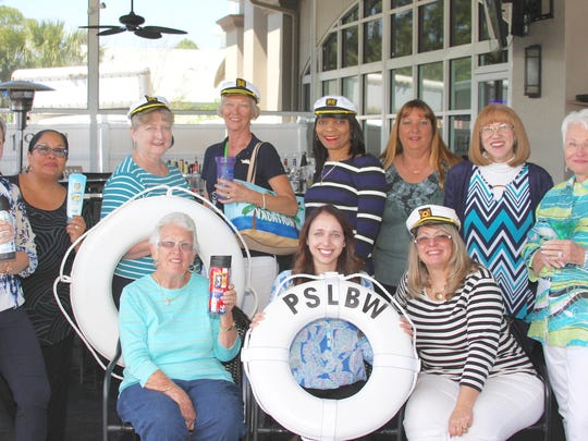 """Port St. Lucie Business Women's Fashion Show Committee members (seated) Marilyn Lawless, Lauren Koff, Tammy Crandell, (standing) Pam Houghton, Loretta Millan, Elaine Anderson, Shirley Melachrinoudis, Angela Hayle, Michele Backus, Dorothy Kamm and Robbi Giaccone are ready to go """"Sailing in Style"""" at the 27th annual Luncheon and Fashion Show."""