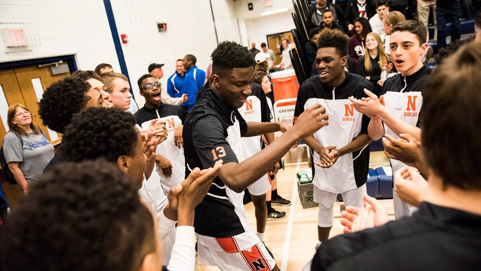 Northeastern players dance before warming up  for Friday's