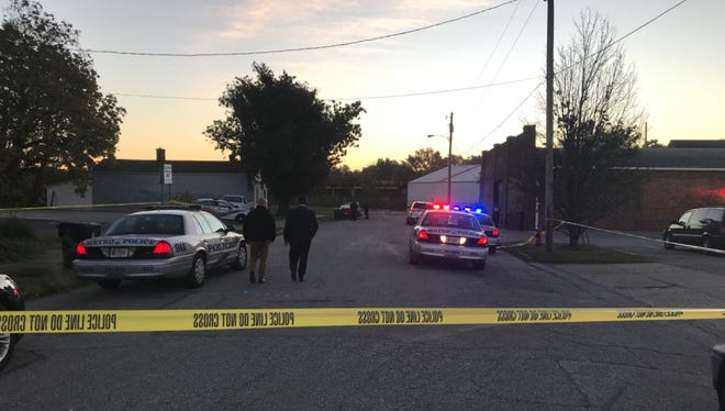 A crime scene taped off in the 900 block of E. Gray Street in Phoenix Hill after a man was shot Tuesday morning.