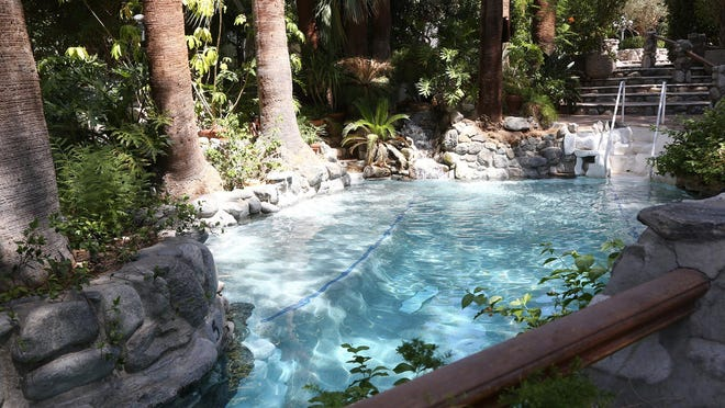 The grotto invites guests at Two Bunch Palms Spa Resort in Desert Hot Springs to partake of its mineral waters and lush surroundings.