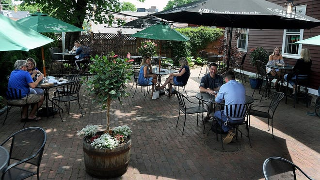 Patrons enjoy lunch back in June at Stone's Public House on Main Street in Ashland.