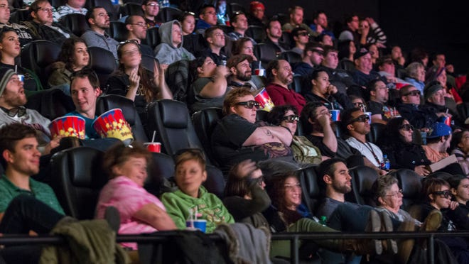 """Fans of """"The Hobbit"""" wait for """"The Desolation of Smaug"""" to begin at the midnight showing Dec. 12, 2013, at Penn Cinema Riverfront. Penn Ketchum says the theater's IMAX screen helps draw fans and keep their losses lower than the rest of the theater industry."""