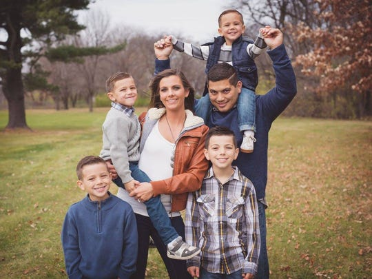 Amy Carey (center) of Elkhart with her husband and four boys. Three-year-old son Cason (top) got trapped in a van earlier this month, but Carey found him 20 minutes later. Cason only suffered minor heat exhaustion.