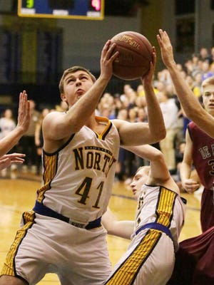 Sheboygan North's David Sonnentag (41) aims for the basket against De Pere Thursday February 25, 2016 at North.