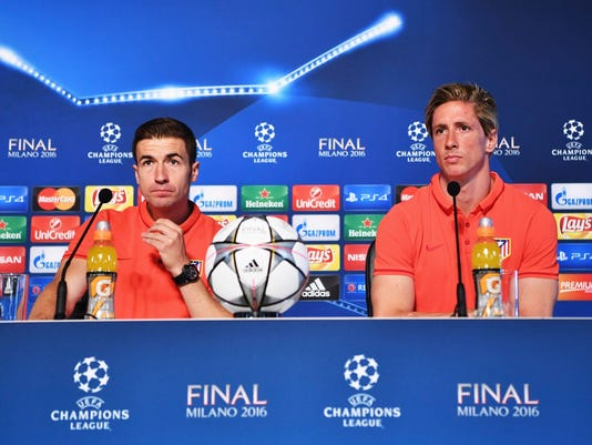 In this photo provided by UEFA Atletico Madrid players Fernando Torres, right, and Gabi attend a press conference at the San Siro stadium in Milan, Italy, Friday, May 27, 2016. The Champions League final soccer match between Real Madrid and Atletico Madrid will be held at the San Siro stadium on Saturday, May 28. (Stuart Franklin UEFA via AP)