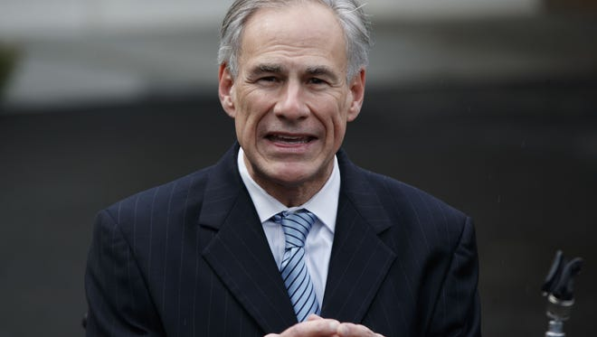 FILE - In this March 24, 2017, file photo, Texas Gov. Greg Abbott talks to reporters outside the White House in Washington.