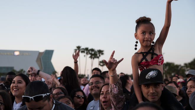 Audience members wait for Jenny and the Mexicats to take the stage during Fiesta de La Flor on Saturday, April 14, 2018.