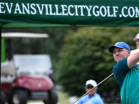 Brycen Moore tees off on No. 1 during a qualifying round of the Men's City Golf Tournament played at Evansville's Fendrich Golf Course on Saturday, July 21, 2018.